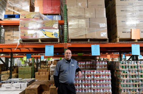 Chuck Moore, executive director of the Food Pantry Network of Licking County, in the food pantries warehouse location on Brice Street in Newark.