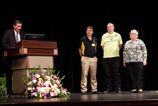 LMHS president and CEO Rob Montagnese recognizes representatives of the West Licking Special Olympics coach Jim Hartley, participant Adam Hare, and coordinator Vicki Sussman as the receive the Mary Jane McDonald Building a Healthier Community Award. The organization serves 120 athletes in sports such as basketball, bowling, cheerleading, tennis, track, cycling and golf.