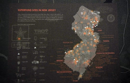 """A display showcasing mines and Superfund sites in Ringwood, NJ, within the """"Climates of Inequality"""" exhibit hosted by Rutgers-Newark in the Hahne and Company building on Wednesday, Oct. 30, 2019, in Newark."""