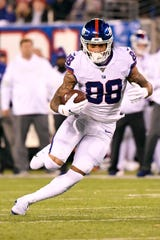 New York Giants tight end Evan Engram (88) rushes against the Dallas Cowboys in the first half. The New York Giants host the Dallas Cowboys in NFL Week 9 on Monday, Nov. 4, 2019, in East Rutherford.
