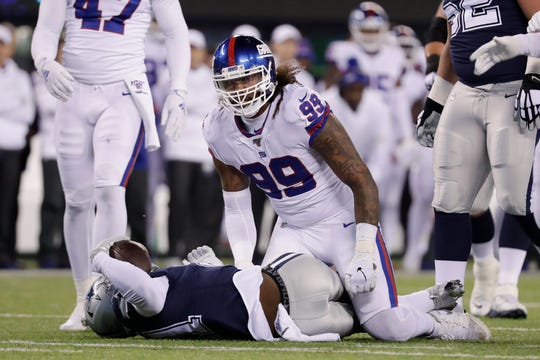 New York Giants defensive end Leonard Williams (99) reacts after tackling Dallas Cowboys running back Ezekiel Elliott (21) during the first quarter of an NFL football game, Monday, Nov. 4, 2019, in East Rutherford, N.J. (AP Photo/Adam Hunger)
