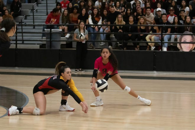 Centennial's Andreya Hesser gets the serve-recieve up as Bella Castro watches. Las Cruces High School and Centennial High School played on Monday at Oñate.