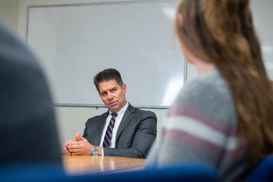 David Lance Bowdich, deputy director of the Federal Bureau of Investigation, speaking to  students Kelsey Phillips and  Daniel Topete along with faculty in the Criminal Justice department at Breland Hall on Nov. 4, 2019.