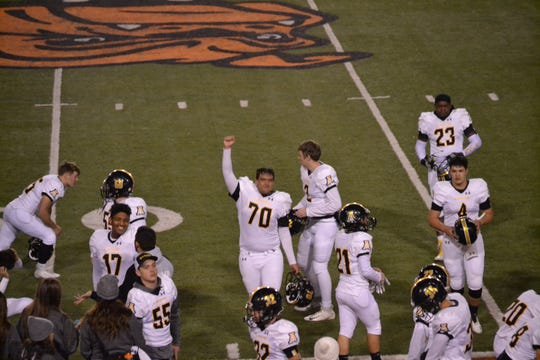 Alamogordo Tigers senior Nickolas Cajen raises his hand in celebration during Alamogordo's 28-22 win over Artesia on Nov. 1, 2019. The Tigers travel to Santa Teresa in the first round of the Class 5A playoffs on Friday.