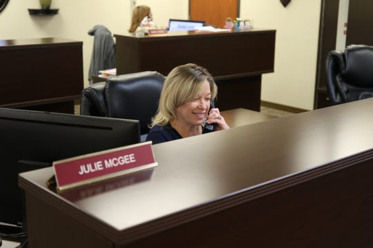 Julie McGee answers a voting question Tuesday at the Eddy County Clerk's Office.