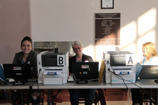 Otero County poll workers Cameron Whiteside Lyn Essex and Marcia Skaar at the Tays Special Events Center in Alamogordo Nov. 5.