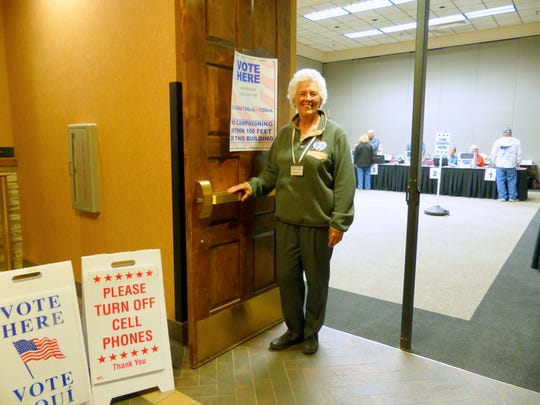 Diana Billingsley stands at  the entrance to the Ruidoso Convention Center voting center Tuesday.