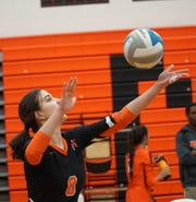 Mustang Jaden Rice prepares to serve.
