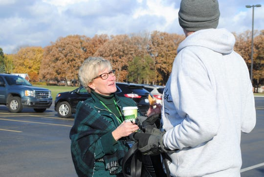 Maureen Miller Brosnan speaking to a voter on Tuesday.