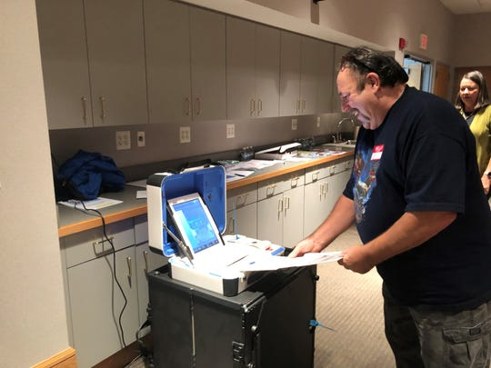 Scott McFadden feeds his ballot into the machine at South Lyon City Hall on Election Day, Nov. 5, 2019.