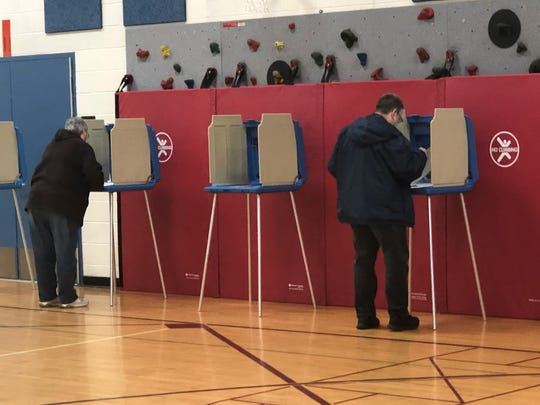 Betsy and Ted Lambert of Milford cast yes votes on the Huron Valley Schools proposal on Tuesday, Nov. 5, 2019 in the Johnson Elementary gym, site of precinct 2.