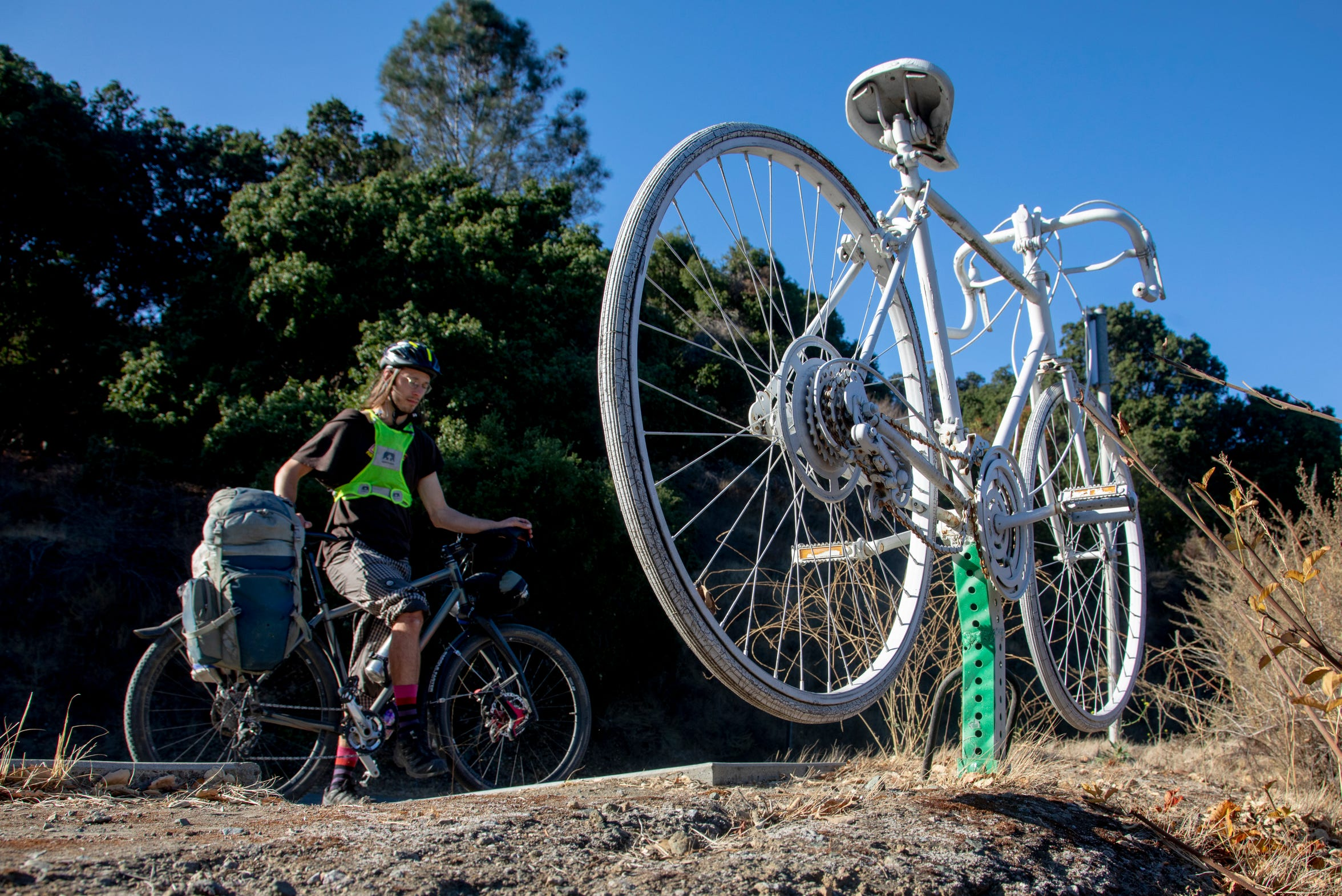 "A roadside memorial marks the spot where Santa Clara County Sheriff's Deputy James ""Tommy"" Council dozed off at the wheel and plowed into a group of cyclists, killing Kristy Gough and Matt Peterson."