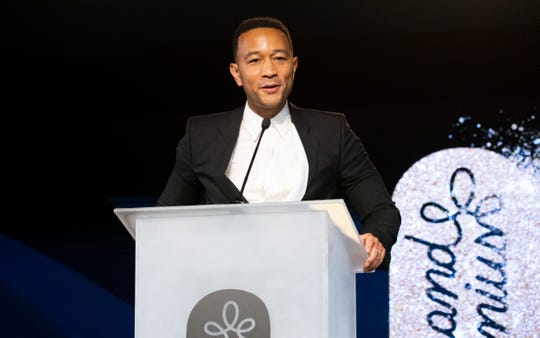 John Legend introduces his wife, Chrissy Teigen, who received the Brand Visionary award at the Brandweek Brand Genius Awards Gala at the JW Marriott Desert Springs Resort & Spa in Palm Desert, Calif., Nov. 4, 2019.