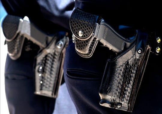 The news organizations' review found judges routinely grant cops who are the subject of restraining orders exemptions that allow them to keep their weapons.
