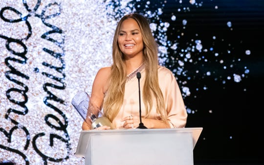 Chrissy Teigen accepts the Brand Visionary award during Brandweek's Genius Awards Gala at the JW Marriott Desert Springs Resort & Spa in Palm Desert, Calif., Nov. 11, 2019.