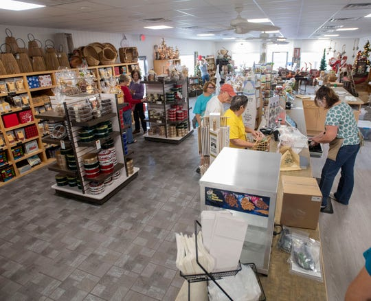 Customers shop Tuesday at the new J.W. Renfroe Pecan Co. location in downtown Pensacola.