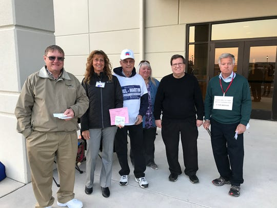 From left to right, Tom Klunk, Charlotte Shaffer, Louann Boyer, Jeffery A. Sheely and Tom Weaver hand out push cards to voters who come to the Southeastern Adams Volunteer Emergency Services (S.A.V.E.S.) building, 5865 Hanover Rd, on Tuesday, Nov. 5, 2019. All are running for Conewago Township supervisor positions. Bob Miller, wearing the white hat, was there in support of county commissioners' re-election.
