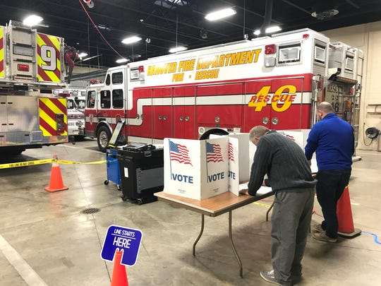 Voters cast their ballots at the Wirt Park Fire Station, 201 N Franklin St., on Tuesday, Nov. 5, 2019.