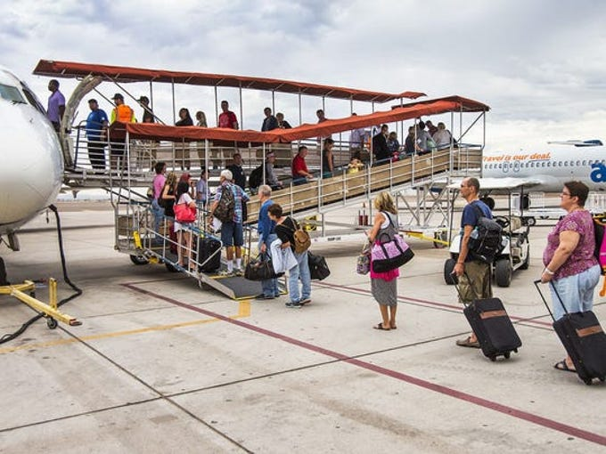 Passengers board an Allegiant Airlines flight at Phoenix-Mesa Gateway Airport in the Southeast Valley.