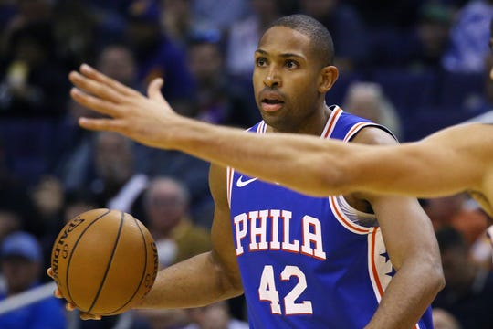 Philadelphia 76ers forward Al Horford dribbles the ball during the first half of an NBA basketball game against the Phoenix Suns Monday, Nov. 4, 2019, in Phoenix. (AP Photo/Ross D. Franklin)