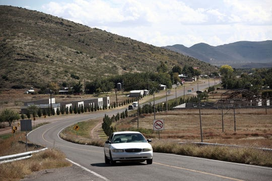 A car passes through Colonia LeBaron, one of many locations where the extended LeBaron family lives in the Galeana municipality of Chihuahua state in northern Mexico, on Tuesday, Nov. 5, 2019. Drug cartel gunmen ambushed on Monday three vehicles along a road near the state border of Chihuahua and Sonora, slaughtering at least six children and three women from the extended LeBaron family, all of them U.S. citizens living in northern Mexico, authorities said.