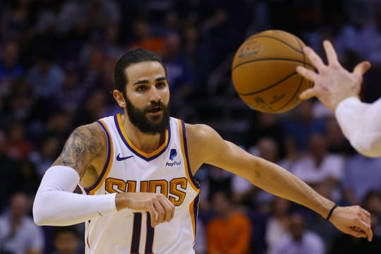 Phoenix Suns guard Ricky Rubio passes the ball against the Philadelphia 76ers during the second half of an NBA basketball game Monday, Nov. 4, 2019, in Phoenix. The Suns defeated the 76ers 114-109. (AP Photo/Ross D. Franklin)