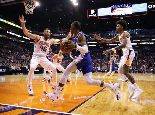 Phoenix Suns center Aron Baynes (46) and forward Kelly Oubre Jr. (3) double-up on Philadelphia 76ers guard Josh Richardson (0) in the second half on Nov. 4, 2019 in Phoenix, Ariz.