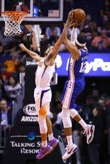 Phoenix Suns guard Devin Booker (1) pressures the shoot by Philadelphia 76ers forward Tobias Harris (12) in the first half on Nov. 4, 2019 in Phoenix, Ariz.