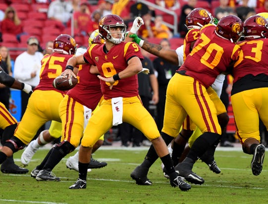 USC quarterback Kedon Slovis (9) looks to pass during a game against Oregon on Nov. 2 at the Los Angeles Memorial Coliseum.