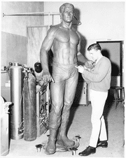 A 1960s photograph shows Charles Bonney sculpting the statue.