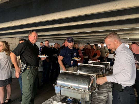 Attendees of the barbecue fundraiser serving themselves food on Nov. 5, 2019.