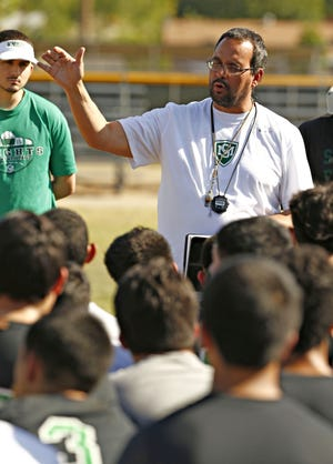 St. Mary's High School head football coach Tommy Brittain speaks to his team prior to Monday football practice at the St. Mary's practice facility on May 2, 2016.