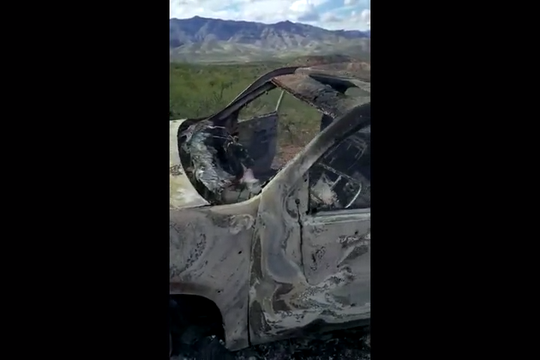 """""""Nita and ... my grandchildren are burned and shot up,"""" a man says as he films a vehicle attacked near La Mora, Sonora, on Nov. 4, 2019."""
