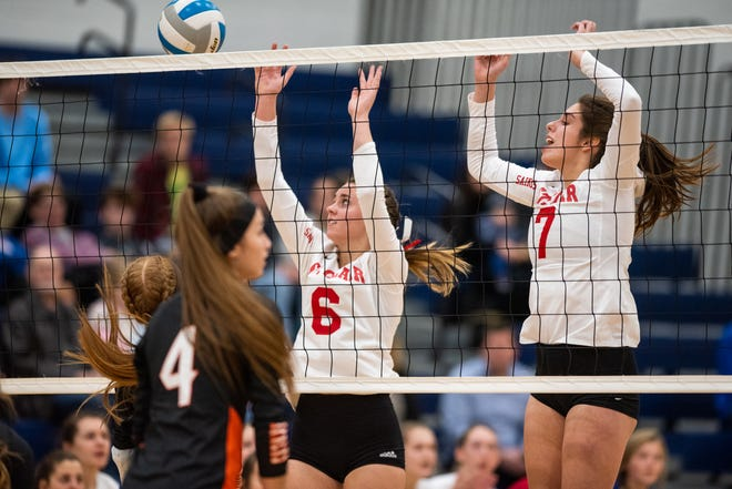 St. Clair's Isabelle Agosta (6) and Allie Foucher jump to block the ball during their MHSAA Division 2 pre-district match against Marine City on Monday, Nov. 4, 2019, at Marysville High School.