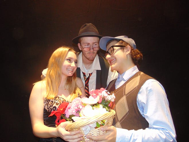 "Macy Hammond (Audrey), left to right, Cody Usher (Mr. Mushnik) and Johnny Mulcahy (Seymour) are shown in rehearsal for Spackenkill High School's production of ""Little Shop of Horrors,"" playing Nov. 8-10."