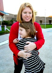 York County Prothonotary candidate Allison Blew hugs her daughter Lydia, 8, as Blew's family joins her at the Windsor Township Municipal Center before she voted on Election Day Tuesday, November 5, 2019. Her husband Nate, father-in-law Russ and daughter Katie, 4, also met her at the poll. Bill Kalina photo