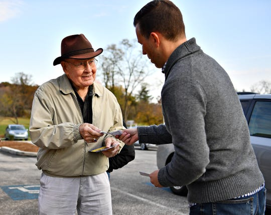 Central York school board candidate Kyle King, right, greets Don Eckert, as Eckert arrives to cast his vote during Election Day at Commonwealth Fire Co. #1 in Springettsbury Township, Tuesday, Nov. 5, 2019. Dawn J. Sagert photo
