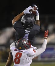 Nevada's Elijah Cooks (4) makes a catch while taking on New Mexico during their football game at Mackay Stadium in Reno on Nov. 2, 2019.