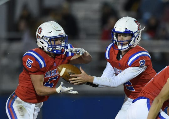 Reno's Kyle Fermoile hands the ball off to Drue Worthen against Spanish Springs last month.