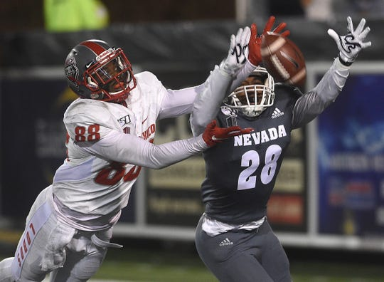Nevada's Austin Arnold (28) defends a pass against New Mexico's Marcus Williams during their football game at Mackay Stadium in Reno on Nov. 2, 2019.