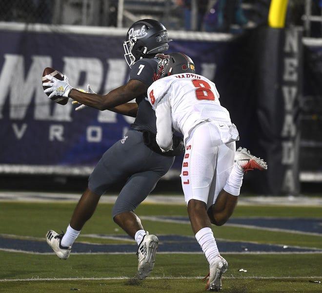 Nevada's Romeo Doubs (7) hauls in a touchdown pass last season against New Mexico.