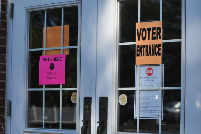 Signs hang outside one of Richmond's vote centers on Election Day, Tuesday, Nov. 5, 2019.