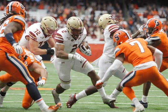 Boston College's AJ Dillon, who ranks among the Top 10 running backs in 2020 NFL draft, gets past the Syracuse defense during the second quarter. He finished with 242 yards and three TDs on 35 carries.