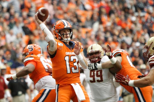 Syracuse's Tommy DeVito passes under pressure from Boston College during the second quarter. The first-year starter has 15 TD passes and 2,075 yards passing, but SU's offense is averaging 16 points fewer per game.