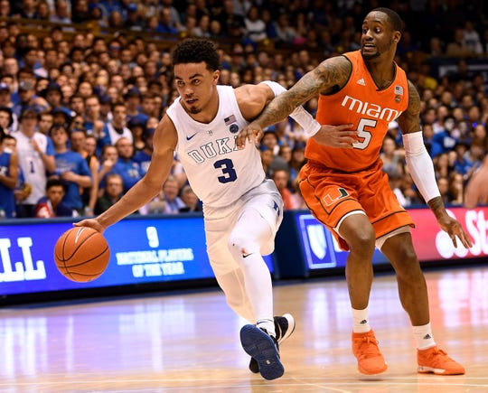 Tre Jones of the Duke Blue Devils beats Zach Johnson of the Miami Hurricanes off of the dribble during the second half of their game at Cameron Indoor Stadium on March 02, 2019 in Durham, North Carolina. Jones and Duke play at Syracuse on Feb. 1.