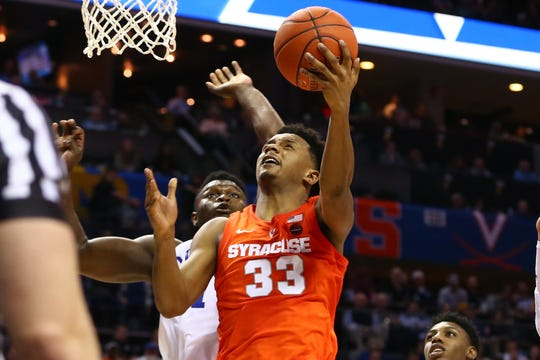 Junior Elijah Hughes averaged 13.7 points last season and is the top returning scorer for Syracuse.