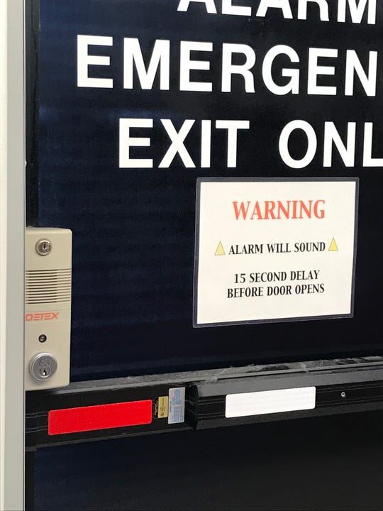 An emergency exit at the Redding TJ Maxx store alerts people that it won't open for 15 seconds. The state building code lets stores to do that to deter would-be shoplifters, but some are concerned it's a security issue.