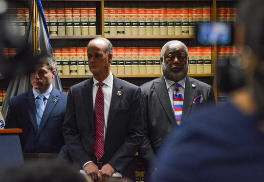 Bossier Sheriff Julian Whittington and Caddo Parish District Attorney James Stewart stand and listen on Tuesday, Nov. 5, 2019, during a news conference in the U.S. Attorney's Office at the Tom Stagg U.S. Courthouse located in downtown Shreveport.