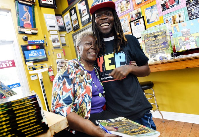 Shreveport author Bertha Harris gives Kendall Hall a hug during the book signing event at Melba's Poboys in New Orleans.