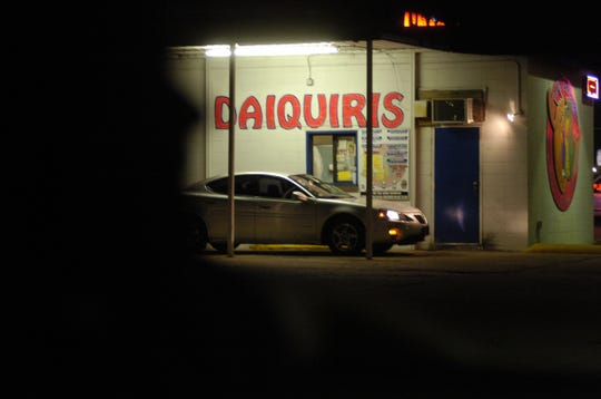 A customer pulls up for a drink at a drive-through daiquiri shop in Shreveport.